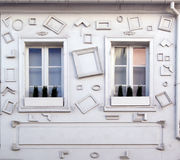 Wall with frames and windows Royalty Free Stock Photo