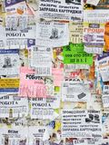 The wall is full of advertisements: offers of work and services, purchase of goods, information about events, advertising stock image