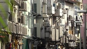 Wall full of air conditioner units, hot day in city