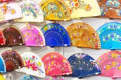 Wall full of Spanish hand-held fans in all kinds of bright, vivid colors. Meant to be sold to tourists as a nice souvenir from Spain Stock Photos