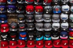 Wall full of team sport caps Stock Images