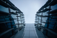 A wall of a futuristic glass-marble office building, from below. Stock Image