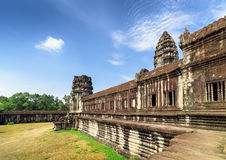 Wall of gallery and one of towers Angkor Wat temple, Cambodia Stock Images