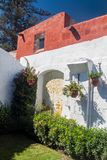 Santa Catalina monastery in Arequipa. Wall and a garden in Santa Catalina monastery in Arequipa, Peru stock images