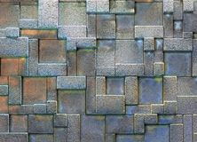 Wall with geometric shapes. Pattern of rectangles on wall Royalty Free Stock Photography