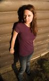 Wall girl 10. Girl posing in front of a camp kitchen wall royalty free stock images