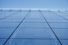 Wall of glass. Sky blue glass wall of modern building Royalty Free Stock Photography