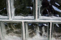 A wall of glass blocks close-up stock photo