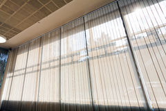 Wall of glass. Covered with white curtains Stock Photography