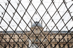 The wall of the glass entrance. Inside the glass pyramid, we can see the beautiful architecture of louvre museum Stock Photography