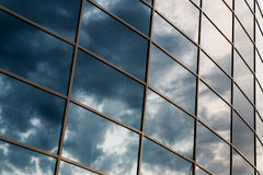 Wall glass skyscraper with reflection of the sky at night Royalty Free Stock Photo