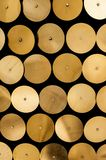 Wall of golden discs. Wall of light reflecting golden discs Stock Images