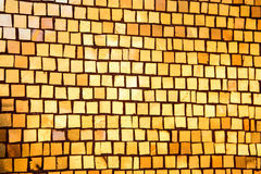 Wall with golden mosaic as texture stock photo