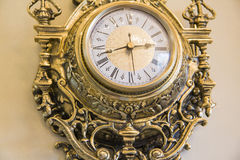 Wall goldish clock. Royalty Free Stock Photo