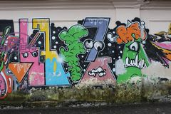 Wall graffiti in the city. Old wall graffiti, urban culture, abstract background Stock Photos