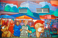 Wall graffiti with crowd protesting against Illegal Immigration reform Stock Images