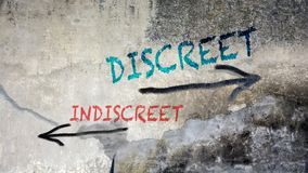 Wall Graffiti Discreet versus Indiscreet. Wall Graffiti the Direction Way to Discreet versus Indiscreet royalty free stock photo
