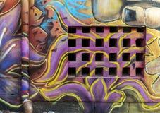 A wall and  graffiti drawings Stock Image