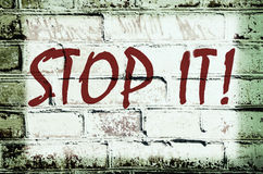 Wall with graffiti that says. Stop it! (abstract background, vintage, grunge - concept Stock Photography
