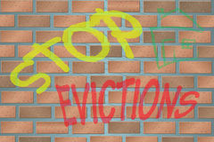 Wall with Graffiti Stop Evictions Royalty Free Stock Image