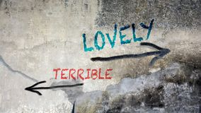 Wall Graffiti to Lovely versus Terrible. Wall Graffiti the Direction Way to Lovely versus Terrible stock images