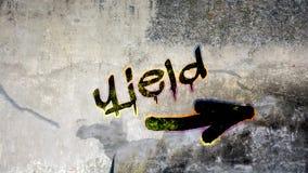Wall Graffiti to Yield. Wall Graffiti the Direction Way to Yield royalty free stock images