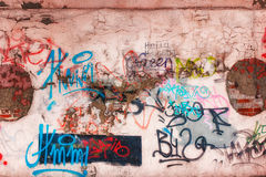 Wall and graffiti. Unreadable inscriptions in different colors Royalty Free Stock Photography
