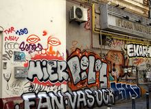 BUCURESTI, ROMANIA-05.19.2018 Wall with graffiti, yellow gas pipes and air conditioning unit on a street in Bucuresti. stock photos