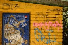 Wall with grafiti. Yellow Brick wall royalty free stock photos