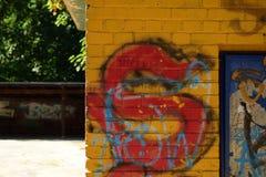 Wall with grafiti. Yellow Brick wall stock photography