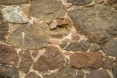 Wall with granit stones. House wall with granite stones Stock Photography