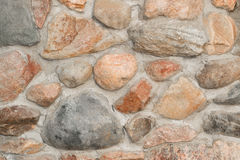 Wall of granite boulders. On cemented masonry royalty free stock photos