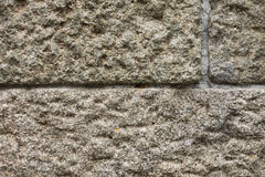 Wall from a granite  with cement seams Stock Images