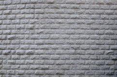 Wall of granite gray stock images