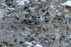 A wall of granite rocks as a background royalty free stock photos