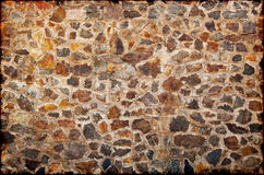 Wall from granite stones. Background in style grunge - a wall from granite stones royalty free stock photos