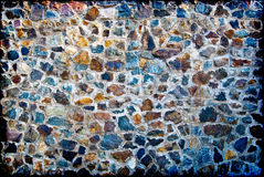 A wall from granite stones. Background in style grunge - a wall from granite stones Stock Photo