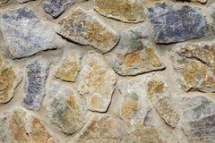 Wall of granite stones. Granite Wall Surface royalty free stock images