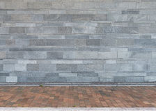Wall of granite stones with paved floor as background Royalty Free Stock Photos