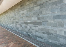 Wall of granite stones with paved floor as background Royalty Free Stock Photography