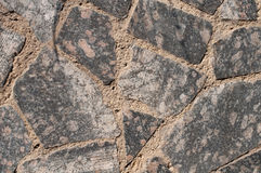 A wall of granite tiles Royalty Free Stock Image