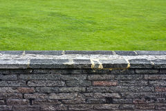 Wall and grass Royalty Free Stock Image