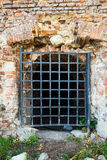 Wall with grates Royalty Free Stock Photos