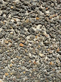 Wall from gravel. The strong brick wall is laid out from numerous gravel Royalty Free Stock Images