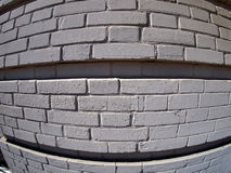 Wall from gray bricks. Close up with wide angle fisheye lens view stock photography