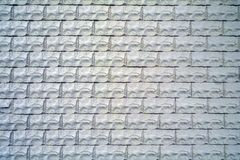 Wall from a gray relief stone for a texture or background Royalty Free Stock Photos