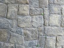 Wall of gray stones, paralelepipedo, gray background, pattern with gray stones. stock photo