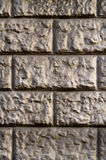 Wall of gray-yellow stone royalty free stock photography