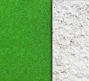 wall with green grass background royalty free stock image