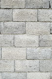 Wall of grey concrete blocks Stock Photo